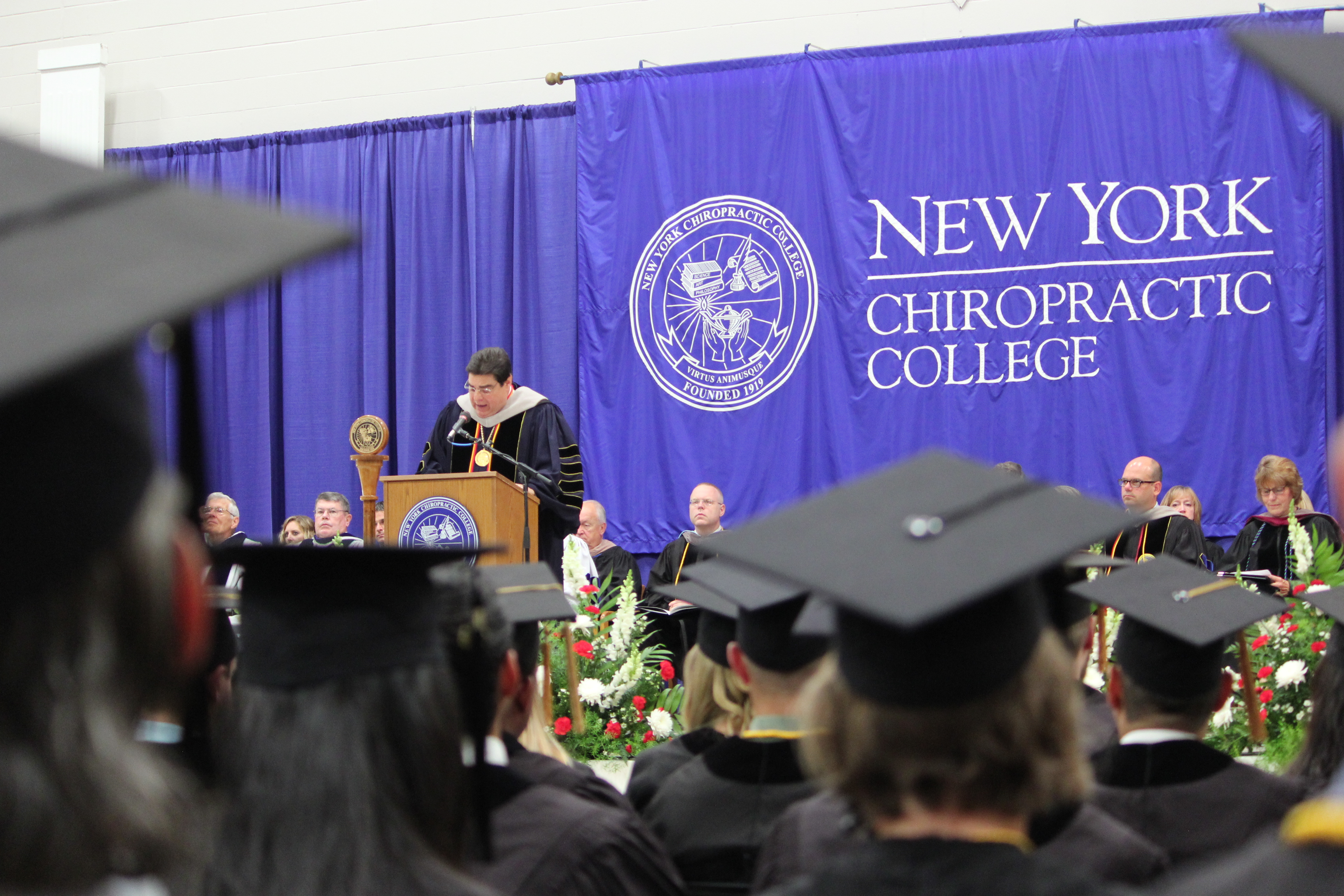 NYCC President, Dr. Frank. J. Nicchi speaking at the July Commencement exercises held at New York Chiropractic College.